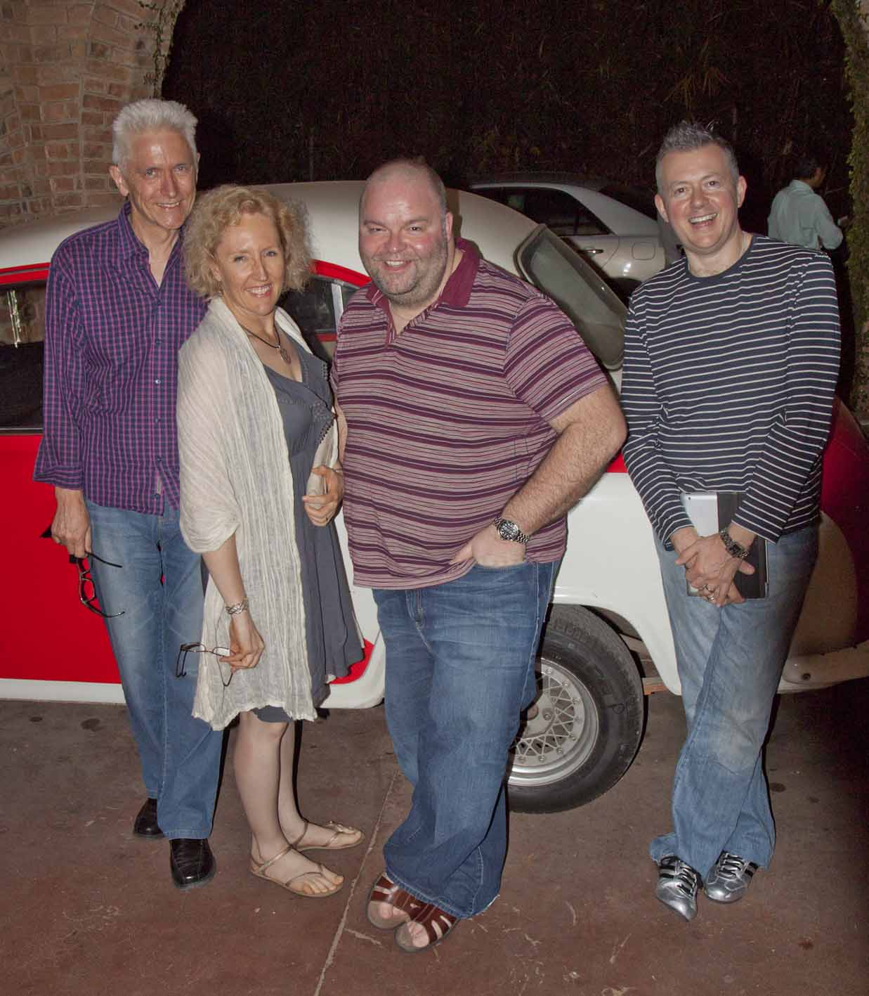 Four friends at Le Planteur Restaurant - about to be given a ride home in the vintage Morris Oxford!